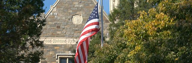 US flag in front of Healy Hall