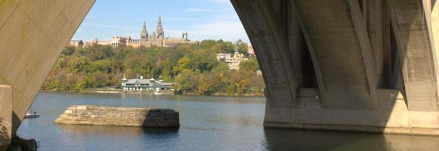 View of Healy Hall from the Potomac River, under the Key Bridge