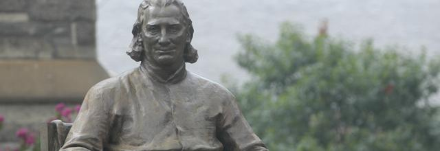 Close-up of John Carroll statue in front of Healy Hall